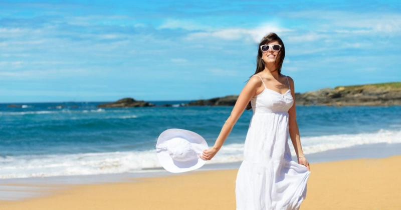 22617758-joyful-woman-in-white-dress-enjoying-and-dancing-on-the-beach-during-summer-lifestyle-walk-relax-tra-stock-photo.jpg